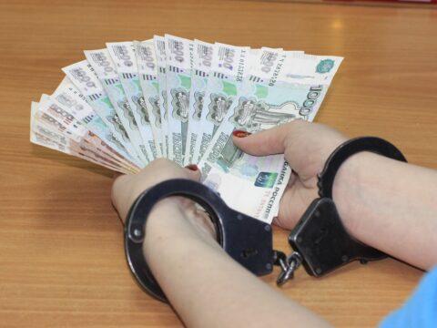 ruce s penězi v poutech